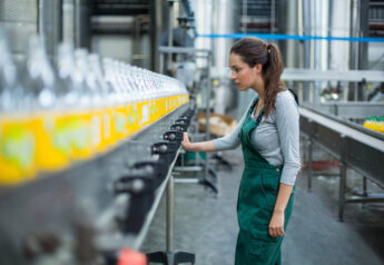 FILE #: 141806480 Preview Crop Find Similar Female factory worker standing near production line
