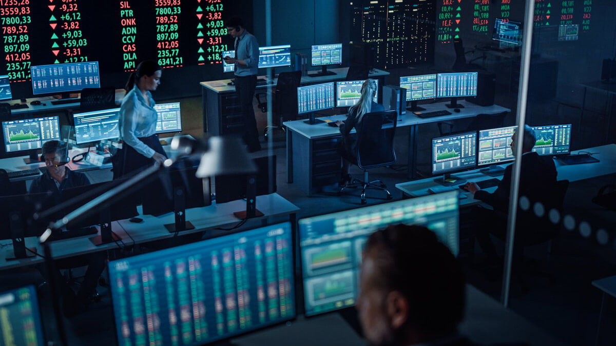 Financial data analysts in a monitoring room