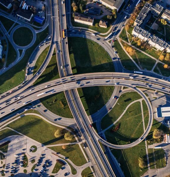overhead shot of a highway network interweaving
