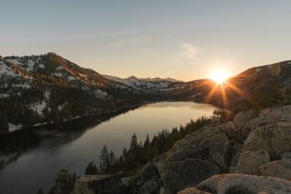 sunrise near mountains and lake