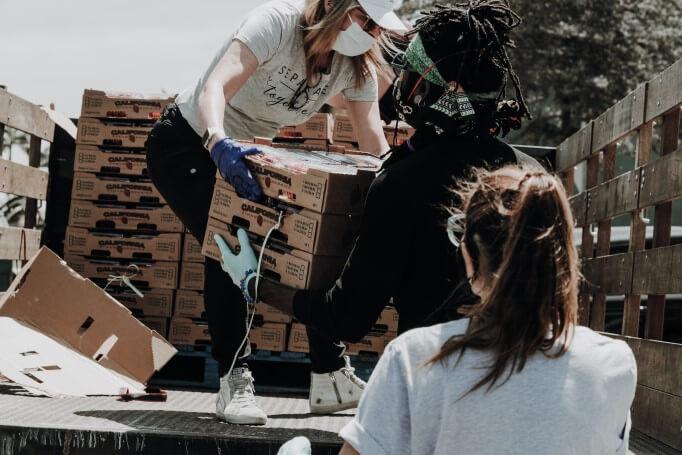 Volunteers unloading food from truck